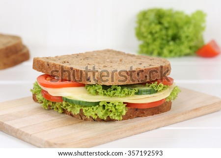 Sandwich toast bread for breakfast with cheese, tomatoes, lettuce - stock photo