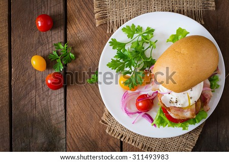 Sandwich with bacon and poached egg. Top view - stock photo