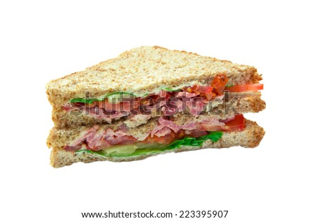 Sandwich with bacon and vegetables on white background - stock photo