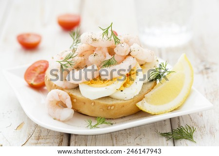 Sandwich with boiled egg and shrimps - stock photo