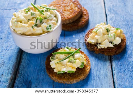 Sandwich with egg salad on a wooden background. Selective focus. - stock photo