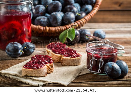 Sandwich with fresh plum jam - stock photo