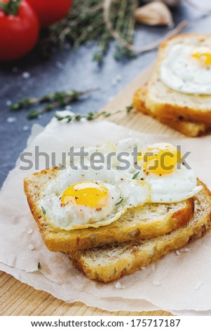 Sandwich with fried eggs - stock photo