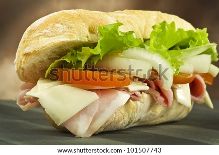 sandwich with ham onion tomatoes salad and cheese - stock photo