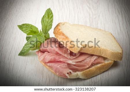 sandwich with Italian prosciutto crudo ,raw ham leg sliced   - stock photo