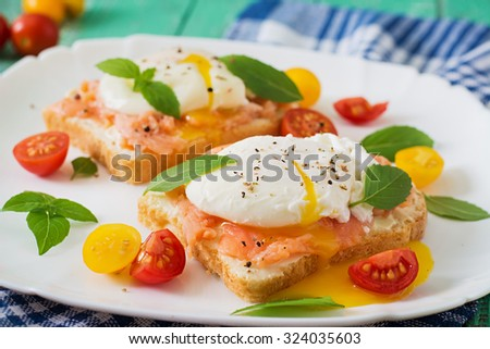 Sandwich with poached eggs with salmon and cream cheese - stock photo
