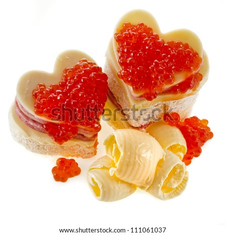 sandwich with red caviar in the form of a heart isolated on white - stock photo