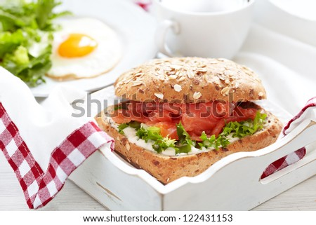 Sandwich with salmon for breakfast - stock photo