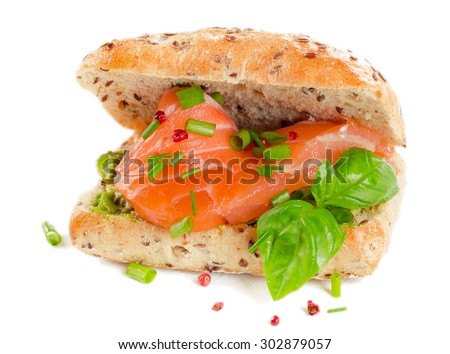 Sandwich with salmon for healthy breakfast isolated on a white. Selective focus - stock photo