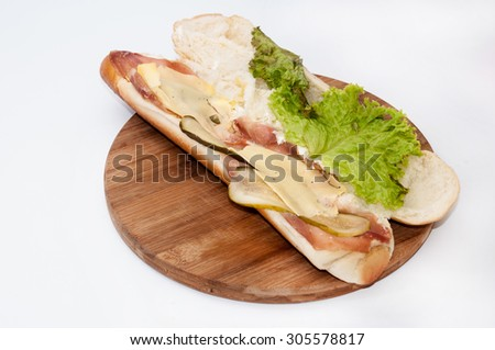 Sandwich with smoked ham, lettuce and vegetables. - stock photo