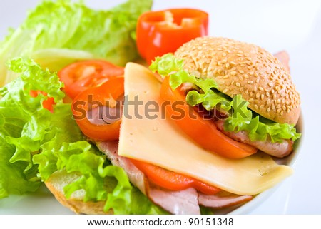 sandwich with smoked meat, cheese and red vegetables - stock photo