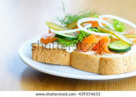 sandwiches on the dish.wood table. - stock photo