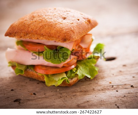 Sandwiches on the wooden table - stock photo