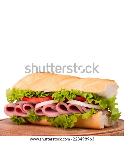 Sandwiches - turkey breast, ham & swiss and salami on a cutting board. Isolated on white background. With clipping path included. - stock photo