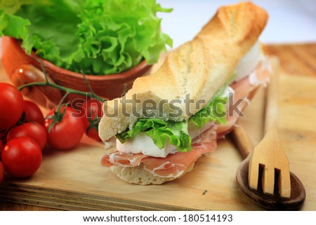 sandwiches with cheese and ham salad tomatoes produced typical Tuscan Italy - stock photo
