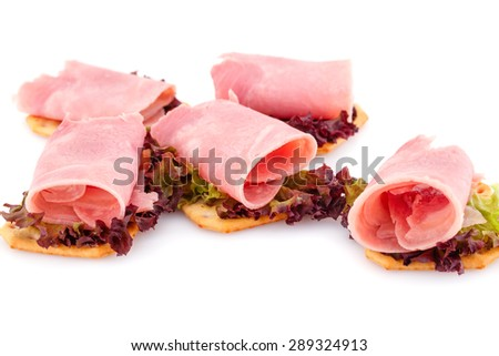 Sandwiches with crackers, bacon and lettuce isolated on white background. - stock photo