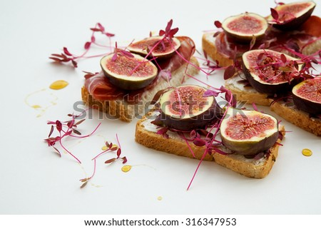 Sandwiches with figs on white background - stock photo