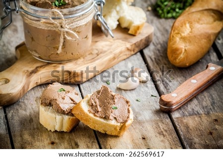 sandwiches with homemade chicken liver pate for breakfast on wooden cutting board - stock photo