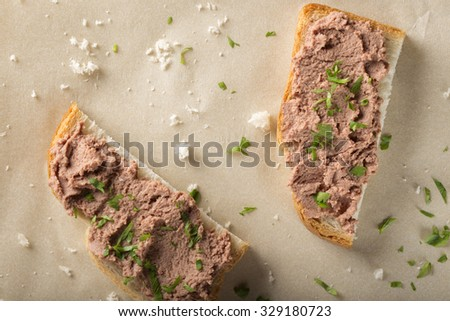 Sandwiches with meat pate. Decorated with green parsley - stock photo