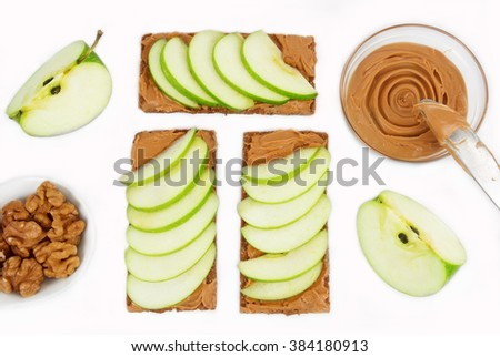 sandwiches with peanut butter and an apple  - stock photo
