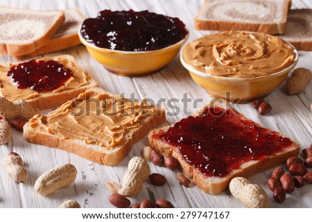 Sandwiches with peanut butter and jelly on the table. horizontal  - stock photo
