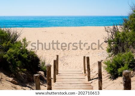 Sandy beach along Green Coast, west Sardinia, Italy - stock photo