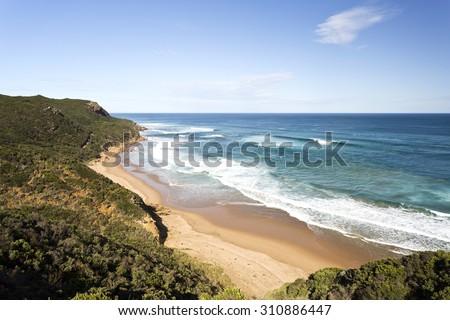 Sandy beach along the coast Great Ocean Road in Victoria, Australia - stock photo