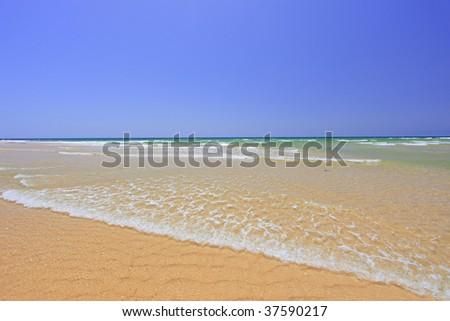 Sandy beach at Faro, Portugal - stock photo