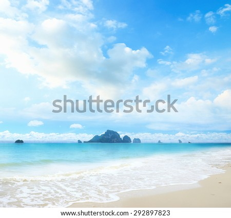 Sandy beach backdrop with turquoise water and bright sun light. Summer holidays concept. World Environment day, Nature Background, Water concept.  - stock photo