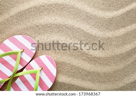 Sandy beach background with flip flops. Summer concept. Top view - stock photo