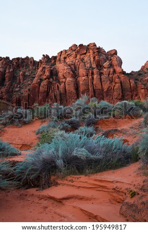 Sandy desert with mountains in the  background - stock photo