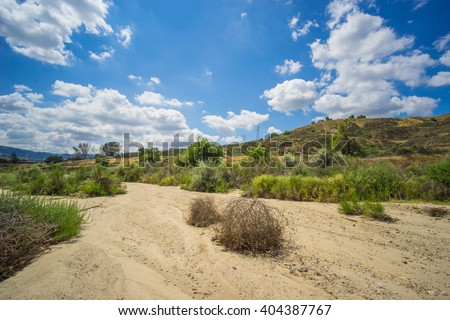 Sandy floor of a dry riverbed during the arid drought in the southwest United States. - stock photo