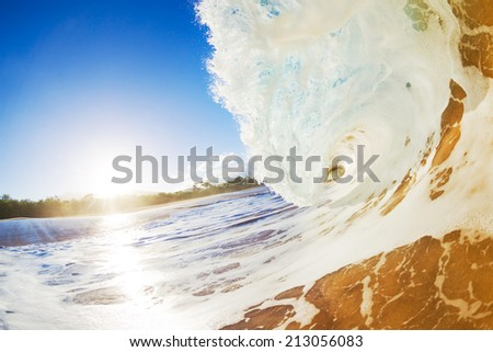 Sandy Ocean Wave Crashing onto the Beach - stock photo