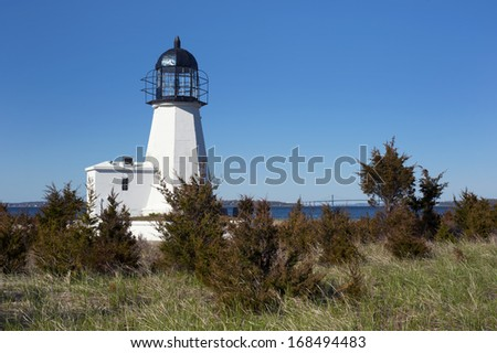 Sandy Point (Prudence Island) lighthouse overlooks Narragansett Bay in Rhode Island. During the hurricane of 1938, the keeper lost his wife and youngest son in the storm. - stock photo