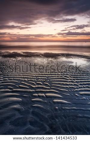sandy ripples in the evening sun - stock photo
