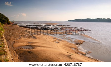 Sandy shore on the estuary of the River Severn near Sharpness in Gloucestershire. - stock photo