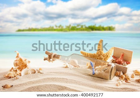 Sandy tropical beach with island on background - stock photo