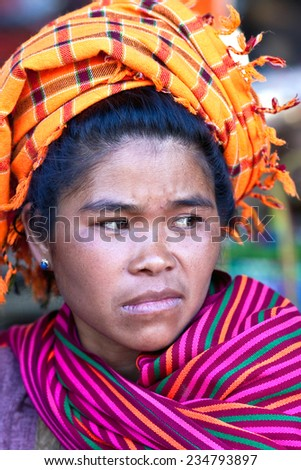 SANGHAR, MYANMAR - JANUARY 15: An unidentified Pa-O tribe woman poses for a photo during local Htamanu Festival on January 15, 2011 in Sanghar Village, Shan state, Myanmar. - stock photo