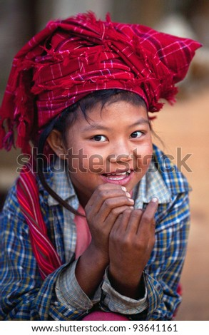 SANGHAR, MYANMAR - JANUARY 17: An unidentified 8-year-old Pa-O tribe girl Soe Soe, poses for a photo during the local Htamanu Festival on January 17, 2011 in Sanghar Village, Shan state, Myanmar - stock photo