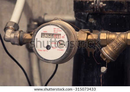 Sanitary equipment. water meter close up - stock photo