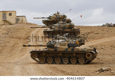SANLIURFA, TURKEY, 13 SEPTEMBER 2014 Turkish soldier and armored vehicle waiting at the Turkey - Syria border around Kobani district. - stock photo