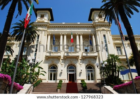 Sanremo casino white facade with palms and flowers - stock photo