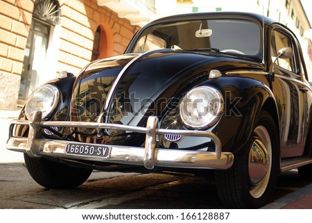 SANREMO, ITALY - MARCH 14: Closeup of a Volkswagen Beetle cruising on the road in Sanremo, Italy on March 14, 2010. - stock photo
