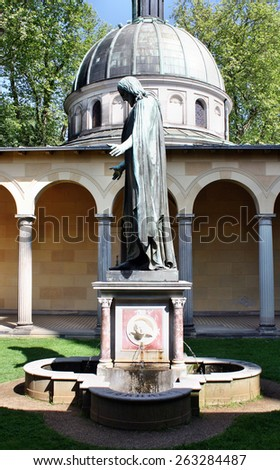 Sanssouci, Potsdam, Germany - May 19, 2013: Church and statue of Jesus Christ in Sanssouci Palace. Sanssouci was the summer residence of Frederick the Great. - stock photo