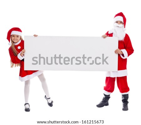 Santa and helper showing blank sign with copy space - stock photo