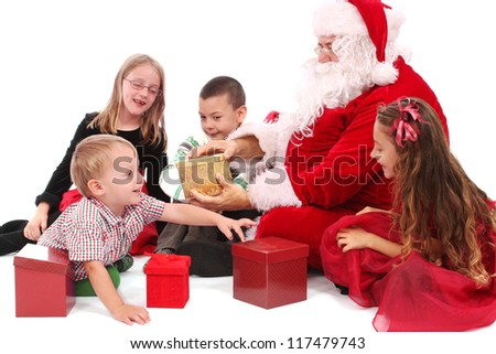 Santa and kids with gifts - stock photo