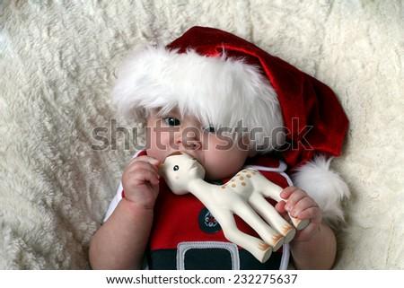 Santa baby with deer - stock photo
