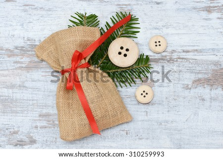 santa bag lying on wood - stock photo