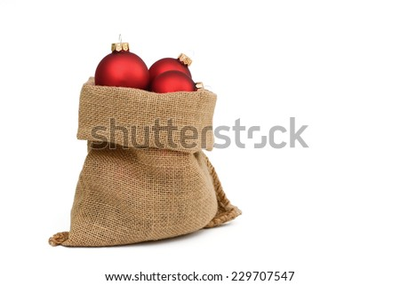Santa bag with xmas balls - stock photo