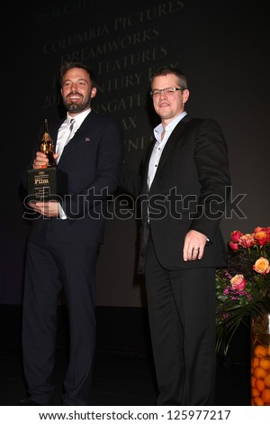 SANTA BARBARA - JAN 25:  Ben Affleck, Matt Damon arrive at the 2013 SBIFF Modern Masters Award presented to Ben Affleck at Arlington Theater on January 25, 2013 in Santa Barbara, CA - stock photo